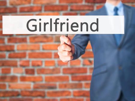 severance: Girlfriend - Businessman hand holding sign. Business, technology, internet concept. Stock Photo