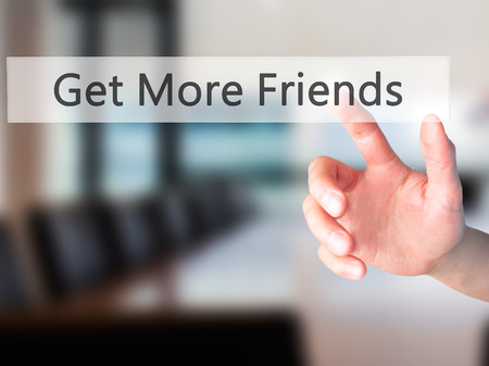 Get More Friends - Hand pressing a button on blurred background concept . Business, technology, internet concept. Stock Photo Stock Photo