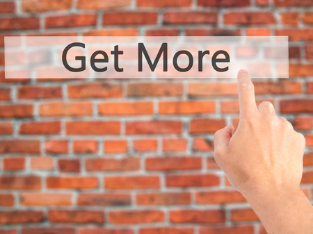 likes: Get More - Hand pressing a button on blurred background concept . Business, technology, internet concept. Stock Photo