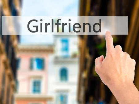 severance: Girlfriend - Hand pressing a button on blurred background concept . Business, technology, internet concept. Stock Photo