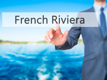 French Riviera - Businessman hand pressing button on touch screen interface. Business, technology, internet concept. Stock Photo Stock Photo