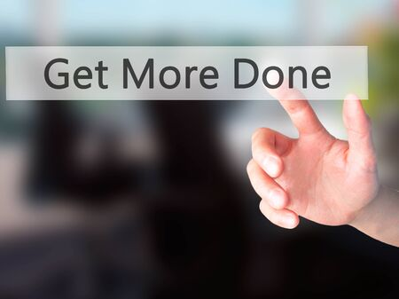 key words art: Get More Done - Hand pressing a button on blurred background concept . Business, technology, internet concept. Stock Photo