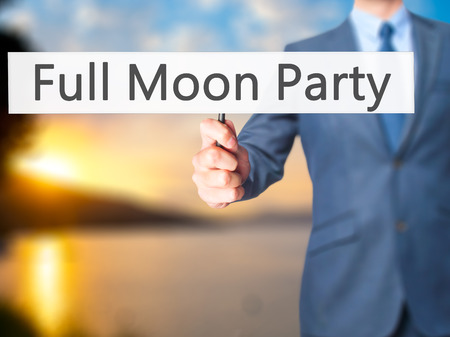 rin: Full Moon Party - Businessman hand holding sign. Business, technology, internet concept. Stock Photo Stock Photo