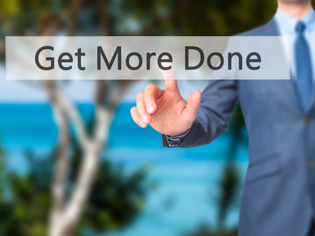 key words art: Get More Done - Businessman hand pressing button on touch screen interface. Business, technology, internet concept. Stock Photo