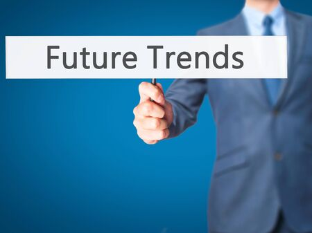 tendency: Future Trends - Businessman hand holding sign. Business, technology, internet concept. Stock Photo