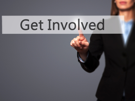 involved: Get Involved - Businesswoman hand pressing button on touch screen interface. Business, technology, internet concept. Stock Photo Stock Photo
