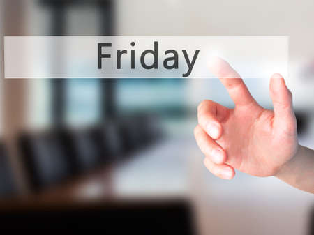 stock photo: Friday - Hand pressing a button on blurred background concept . Business, technology, internet concept. Stock Photo