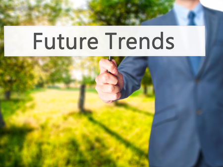 adwords: Future Trends - Businessman hand holding sign. Business, technology, internet concept. Stock Photo