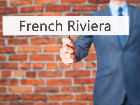 French Riviera - Businessman hand holding sign. Business, technology, internet concept. Stock Photo