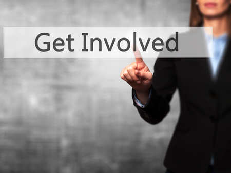involving: Get Involved - Businesswoman hand pressing button on touch screen interface. Business, technology, internet concept. Stock Photo Stock Photo
