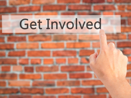 common goal: Get Involved - Hand pressing a button on blurred background concept . Business, technology, internet concept. Stock Photo