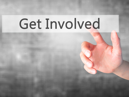 involving: Get Involved - Hand pressing a button on blurred background concept . Business, technology, internet concept. Stock Photo