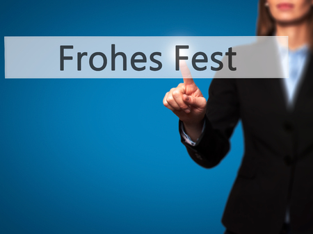 december 25th: frohes fest (Happy Christmas in German)  - Businesswoman hand pressing button on touch screen interface. Stock Photo