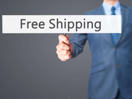 stock photo: Free Shipping  - Businessman hand holding sign. Business, technology, internet concept. Stock Photo
