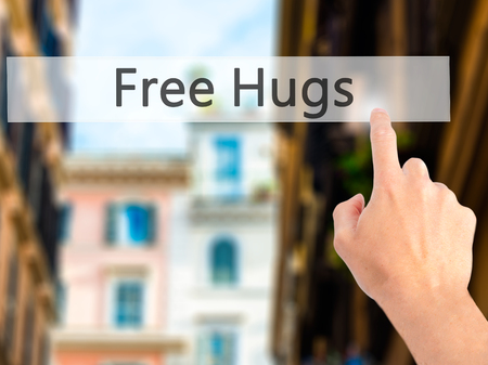 hand free: Free Hugs - Hand pressing a button on blurred background concept . Business, technology, internet concept. Stock Photo