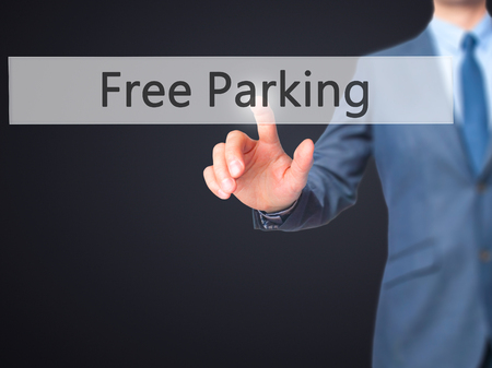 multi story car park: Free Parking - Businessman hand pressing button on touch screen interface. Business, technology, internet concept. Stock Photo Stock Photo