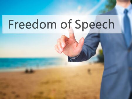 silenced: Freedom of Speech - Businessman hand pressing button on touch screen interface. Business, technology, internet concept. Stock Photo