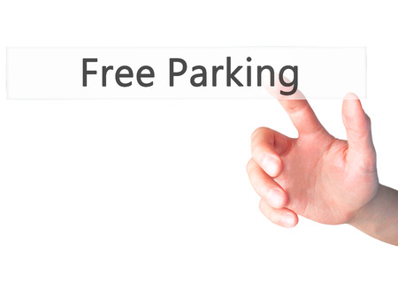 multi story car park: Free Parking - Hand pressing a button on blurred background concept . Business, technology, internet concept. Stock Photo