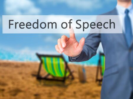 censure: Freedom of Speech - Businessman hand pressing button on touch screen interface. Business, technology, internet concept. Stock Photo