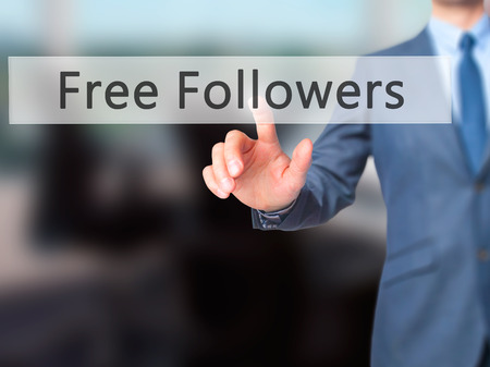 followers: Free Followers - Businessman hand pressing button on touch screen interface. Business, technology, internet concept. Stock Photo