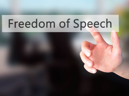 censure: Freedom of Speech - Hand pressing a button on blurred background concept . Business, technology, internet concept. Stock Photo Stock Photo