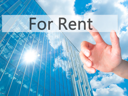 renter: For Rent - Hand pressing a button on blurred background concept . Business, technology, internet concept. Stock Photo