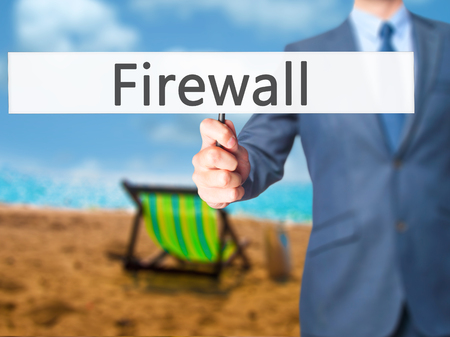 Firewall  - Businessman hand holding sign. Business, technology, internet concept. Stock Photo