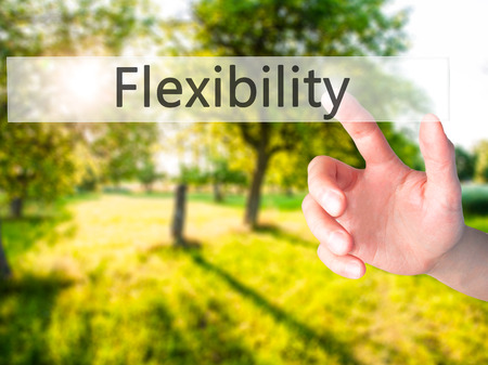 accommodating: Flexibility - Hand pressing a button on blurred background concept . Business, technology, internet concept. Stock Photo Stock Photo