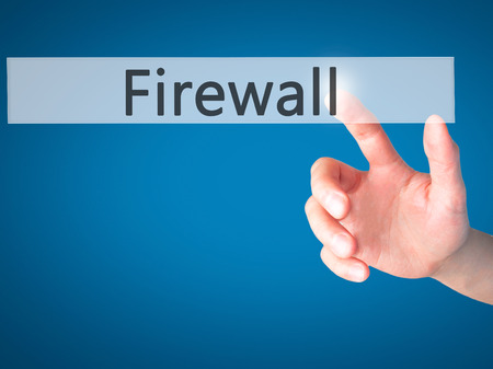 lock block: Firewall  - Hand pressing a button on blurred background concept . Business, technology, internet concept. Stock Photo