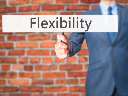 adaptable: Flexibility - Businessman hand holding sign. Business, technology, internet concept. Stock Photo Stock Photo