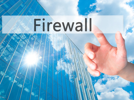 nat: Firewall  - Hand pressing a button on blurred background concept . Business, technology, internet concept. Stock Photo