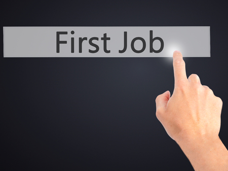 apprenticeship employee: First Job - Hand pressing a button on blurred background concept . Business, technology, internet concept. Stock Photo