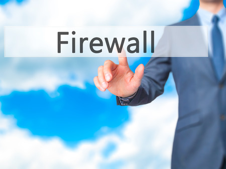 nat: Firewall  - Businessman hand pressing button on touch screen interface. Business, technology, internet concept. Stock Photo