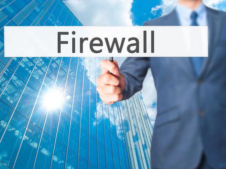 lock block: Firewall  - Businessman hand holding sign. Business, technology, internet concept. Stock Photo