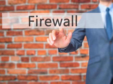 lock block: Firewall  - Businessman hand pressing button on touch screen interface. Business, technology, internet concept. Stock Photo