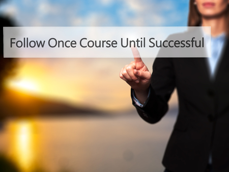 executive courses: Follow Once Course Until Successful - Businesswoman hand pressing button on touch screen interface. Business, technology, internet concept. Stock Photo Stock Photo