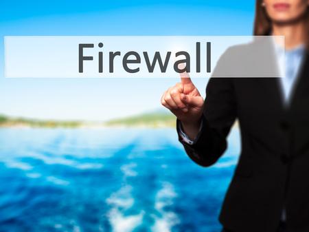 lock block: Firewall  - Businesswoman hand pressing button on touch screen interface. Business, technology, internet concept. Stock Photo