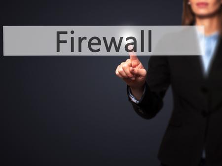 nat: Firewall  - Businesswoman hand pressing button on touch screen interface. Business, technology, internet concept. Stock Photo