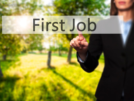 apprenticeship employee: First Job - Businesswoman hand pressing button on touch screen interface. Business, technology, internet concept. Stock Photo