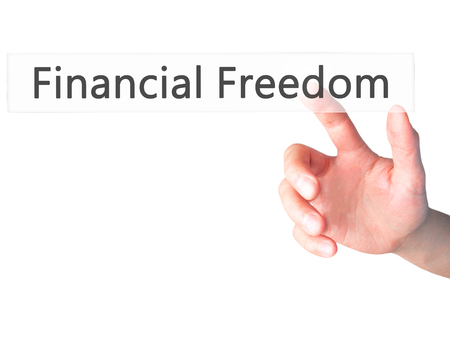 equities: Financial Freedom - Hand pressing a button on blurred background concept . Business, technology, internet concept. Stock Photo