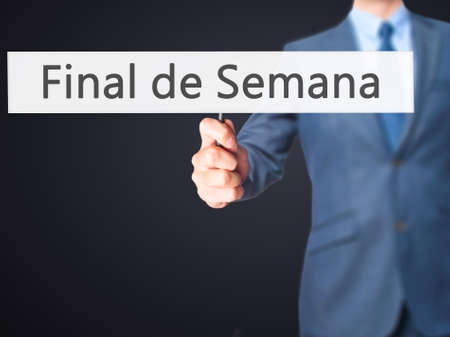 semana: Final de Semana (In portuguese - Weekend) - Businessman hand holding sign. Business, technology, internet concept. Stock Photo