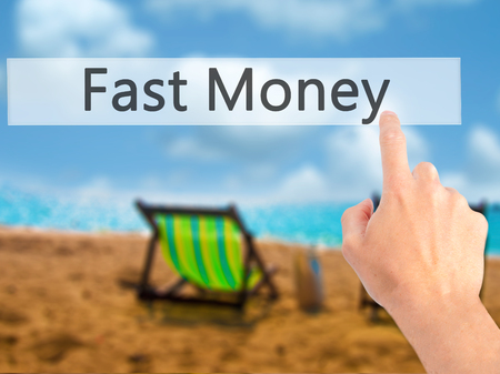 earn google: Fast Money - Hand pressing a button on blurred background concept . Business, technology, internet concept. Stock Photo Stock Photo