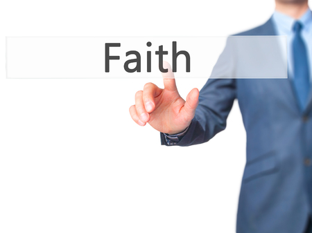 hopefulness: Faith - Businessman hand pressing button on touch screen interface. Business, technology, internet concept. Stock Photo Stock Photo