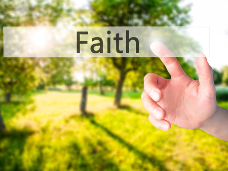 love proof: Faith - Hand pressing a button on blurred background concept . Business, technology, internet concept. Stock Photo