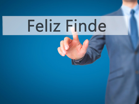 finde: Feliz Finde (Happy Weekend In Spanish)  - Businessman hand pressing button on touch screen interface. Business, technology, internet concept. Stock Photo Stock Photo