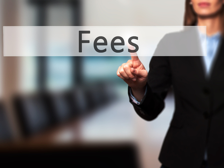 hidden taxes: Fees - Businesswoman hand pressing button on touch screen interface. Business, technology, internet concept. Stock Photo Stock Photo