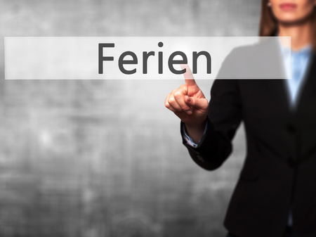 adjournment: Ferien (Vacation in German) - Businesswoman hand pressing button on touch screen interface. Business, technology, internet concept. Stock Photo Stock Photo