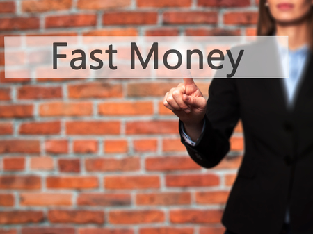 adwords: Fast Money - Businesswoman hand pressing button on touch screen interface. Business, technology, internet concept. Stock Photo Stock Photo