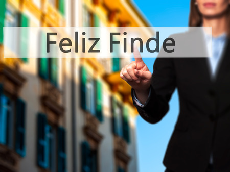 finde: Feliz Finde (Happy Weekend In Spanish)  - Businesswoman hand pressing button on touch screen interface. Business, technology, internet concept. Stock Photo
