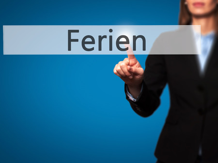 adjourned: Ferien (Vacation in German) - Businesswoman hand pressing button on touch screen interface. Business, technology, internet concept. Stock Photo Stock Photo